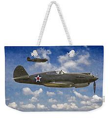 Weekender Tote Bag featuring the digital art Curtis P-40 Warhawks by Kai Saarto