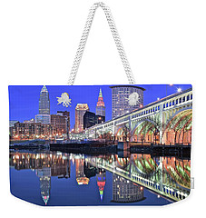 Weekender Tote Bag featuring the photograph Cuyahoga River Blue Hour by Frozen in Time Fine Art Photography