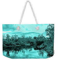 Weekender Tote Bag featuring the photograph Cyan Dreaming - Sarasota Pond by Madeline Ellis