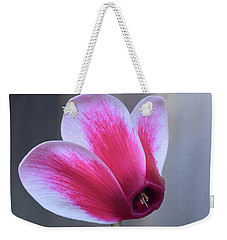 Weekender Tote Bag featuring the photograph Cyclamen Portrait. by Terence Davis