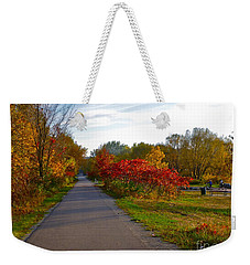 Weekender Tote Bag featuring the photograph Cycling In Heaven by Claire Bull