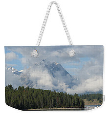 Weekender Tote Bag featuring the photograph Dam Clouds by Greg Patzer