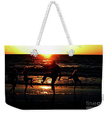 Weekender Tote Bag featuring the photograph Dancing In The Sun by Gary Wonning