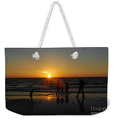 Weekender Tote Bag featuring the photograph Dancing In The Sunset by Gary Wonning