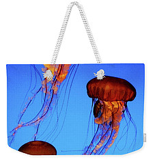 Weekender Tote Bag featuring the photograph Dancing Jellyfish by Anthony Jones
