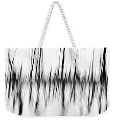 Weekender Tote Bag featuring the photograph Dancing Trees by Darren White