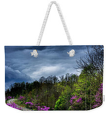 Weekender Tote Bag featuring the photograph Dark Clouds Over Redbud Highway by Thomas R Fletcher