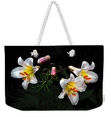 Weekender Tote Bag featuring the photograph Dark Day Bright Lilies by Byron Varvarigos