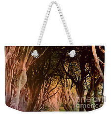 Weekender Tote Bag featuring the photograph Dark Hedges by Mary-Lee Sanders