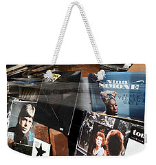 Weekender Tote Bag featuring the photograph David Bowie And Nina Simone - Greenwich Village Record Store by Madeline Ellis