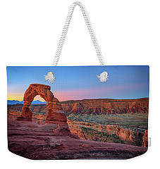 Weekender Tote Bag featuring the photograph Dawn At Delicate Arch by Rick Berk