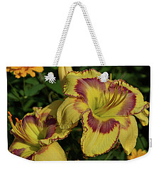 Weekender Tote Bag featuring the photograph Daylilies And Zinnia by Sandy Keeton