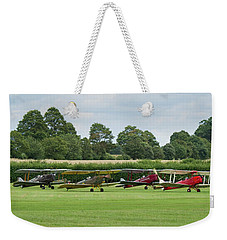 Weekender Tote Bag featuring the photograph De Havilland Tiger Moths Line-up by Gary Eason