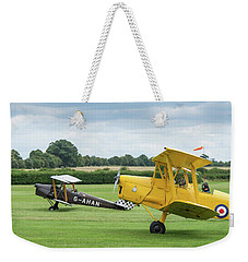 Weekender Tote Bag featuring the photograph De Havilland Tiger Moths Taxiing by Gary Eason