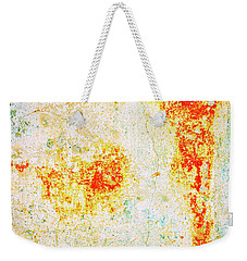 Weekender Tote Bag featuring the photograph Decayed Wall With Orange Paint by Silvia Ganora