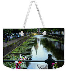 Weekender Tote Bag featuring the photograph Canal And Decorated Bike In The Hague by RicardMN Photography