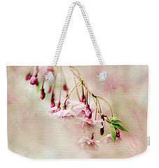 Weekender Tote Bag featuring the photograph Delicate Bloom by Jessica Jenney