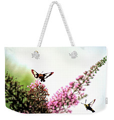 Weekender Tote Bag featuring the photograph Delight And Joy - Hummingbird Moths In Flight by Kerri Farley