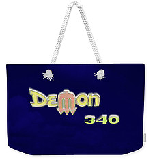 Weekender Tote Bag featuring the photograph Demon 340 Emblem by Mike McGlothlen