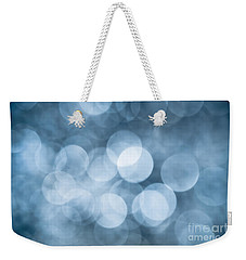 Weekender Tote Bag featuring the photograph Denim Blue Bokeh by Jan Bickerton