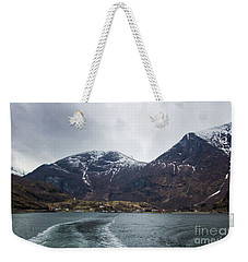 Weekender Tote Bag featuring the photograph Departing Flam by Suzanne Luft