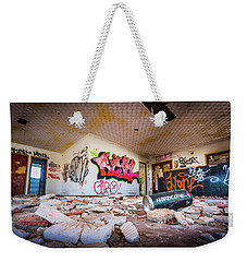 Weekender Tote Bag featuring the photograph Derelict Campsite Building. by Gary Gillette
