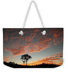 Weekender Tote Bag featuring the photograph Desert Oak Tree Silhouetted At Sunrise by Keiran Lusk