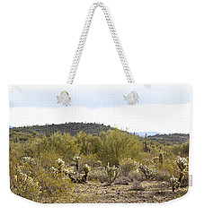 Weekender Tote Bag featuring the photograph Desert Sunrise by Phyllis Denton
