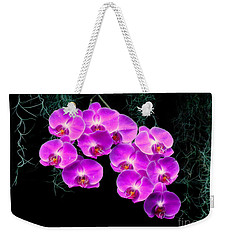 Weekender Tote Bag featuring the photograph Dew-kissed Orchids by Sue Melvin
