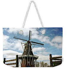 Weekender Tote Bag featuring the photograph Dezwaan Windmill With Fence And Clouds by Michelle Calkins
