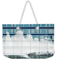 Weekender Tote Bag featuring the photograph Dia Hotel Reflection by Joe Bonita