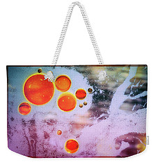 Weekender Tote Bag featuring the photograph Digital Virus Orange One Bubbles by John Williams