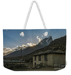 Weekender Tote Bag featuring the photograph Dingboche Nepal Sunrays by Mike Reid