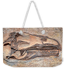 Weekender Tote Bag featuring the photograph Dinosaur Skull And Teeth In Rock - Utah by Gary Whitton