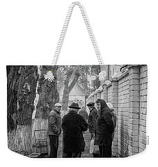 Weekender Tote Bag featuring the photograph Discussion by John Williams