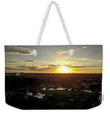 Weekender Tote Bag featuring the photograph Disney Sunset by Michael Albright