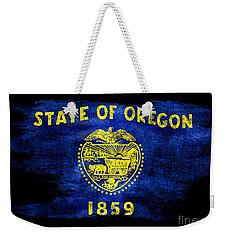 Distressed Oregon Flag On Black Weekender Tote Bag by Jon Neidert