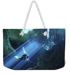 Diver Silhouetted In Sunrays Of Cenote Weekender Tote Bag by Karen Doody