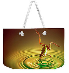 Weekender Tote Bag featuring the photograph Diving by William Lee