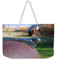 Weekender Tote Bag featuring the photograph Dodge Emblem by Ely Arsha