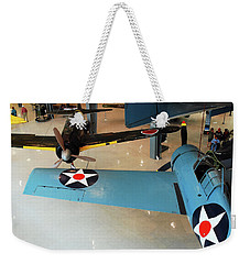 Weekender Tote Bag featuring the photograph Dogfighters by James Kirkikis