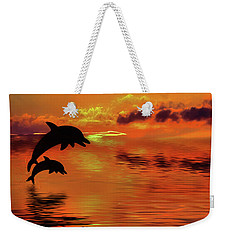 Weekender Tote Bag featuring the digital art Dolphin Silhouette Sunset By Kaye Menner by Kaye Menner