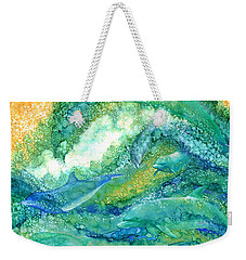 Weekender Tote Bag featuring the mixed media Dolphin Waves 2 by Carol Cavalaris