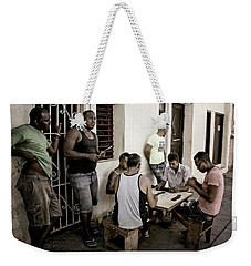 Weekender Tote Bag featuring the photograph Dominoes by Joan Carroll