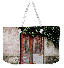 Weekender Tote Bag featuring the photograph Door Covered With Ivy by Marco Oliveira