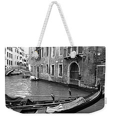 Weekender Tote Bag featuring the photograph Double Parked by Donna Corless