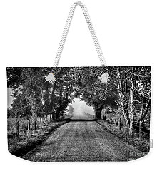 Weekender Tote Bag featuring the photograph Down A Lonely Road by Douglas Stucky