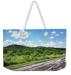 Weekender Tote Bag featuring the photograph Down The Road by Ricky L Jones