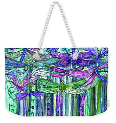 Weekender Tote Bag featuring the mixed media Dragonfly Bloomies 3 - Purple by Carol Cavalaris