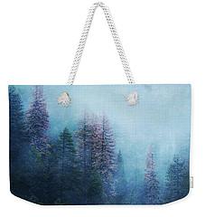 Weekender Tote Bag featuring the digital art Dreamy Winter Forest by Klara Acel